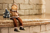 Vintage Christmas Ceramic figurine man in warm clothes