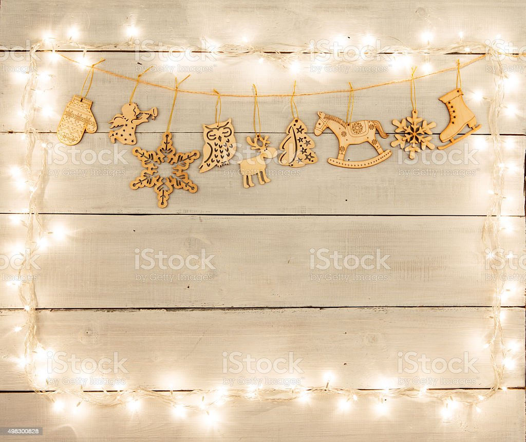 Vintage christmas decoration on wooden table - angel, deer, hous stock photo