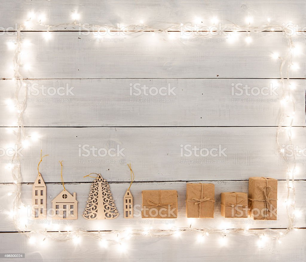 Vintage christmas decoration on wooden table -  houses, tree, xm stock photo