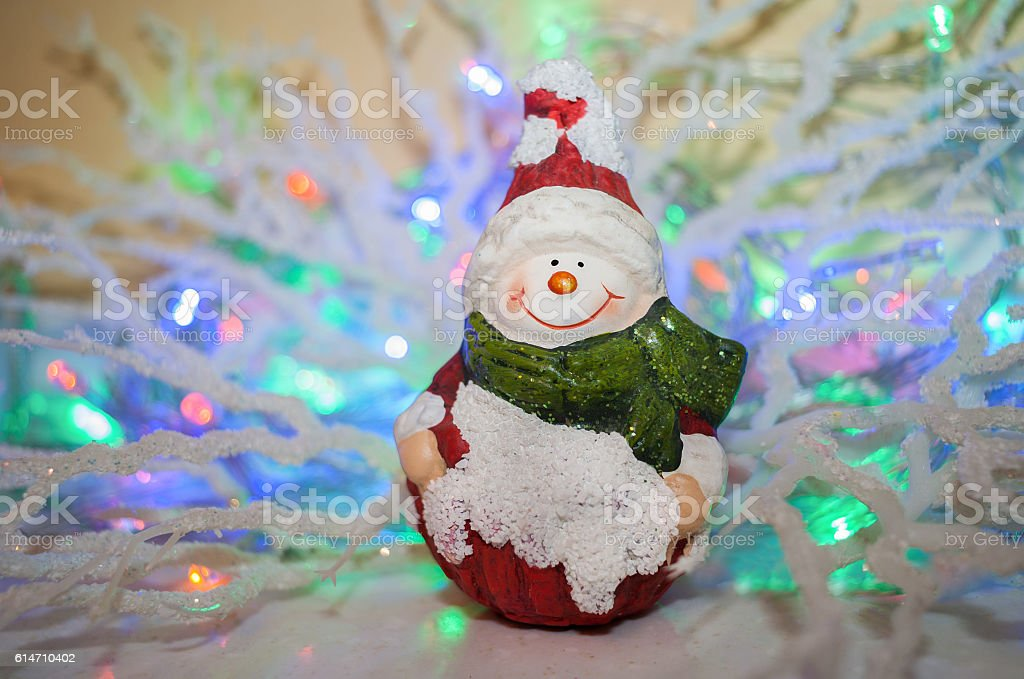 Vintage Christmas toy smiling snowman on a beautiful colored background. stock photo