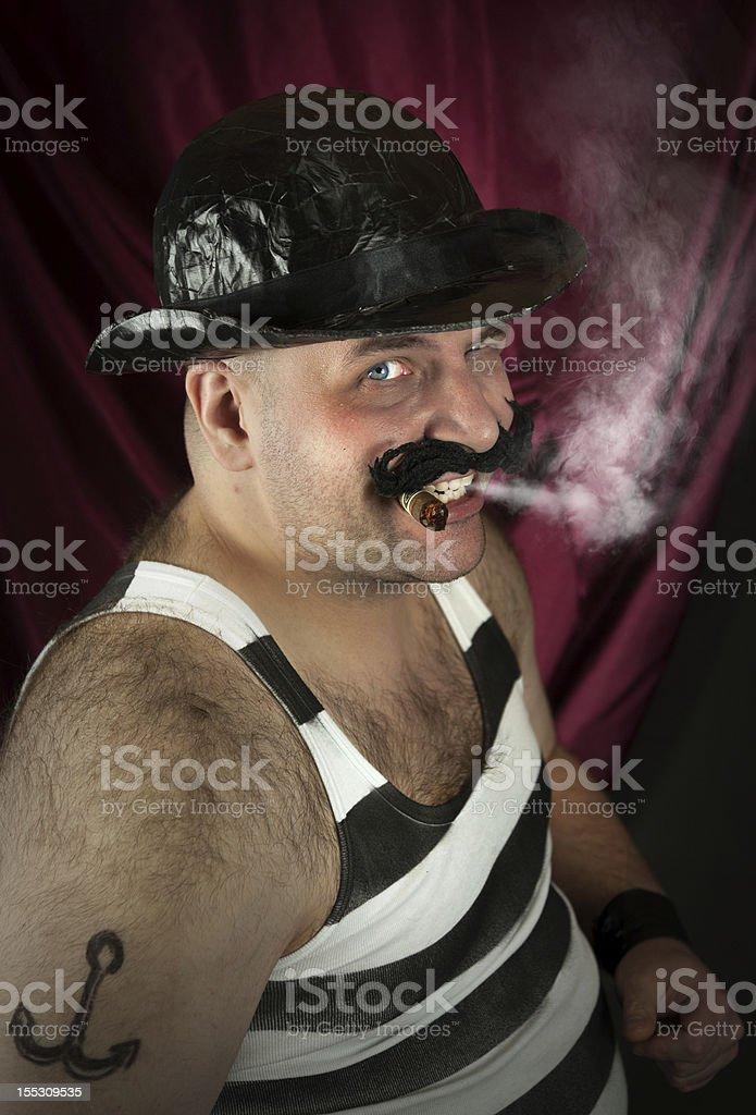 Vintage circus strongman smoking royalty-free stock photo