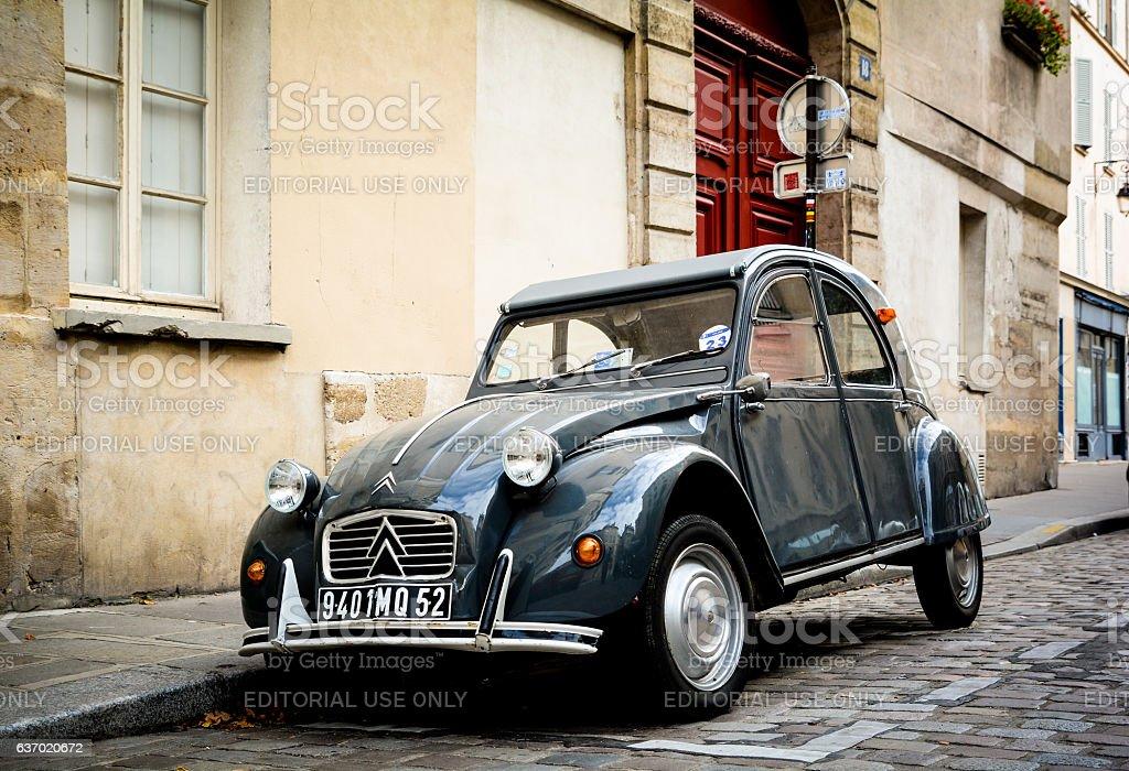 Vintage Citroen car on narrow cobblestone street stock photo