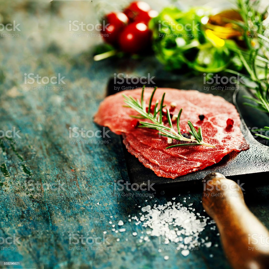 vintage cleaver and Beef Carpaccio stock photo