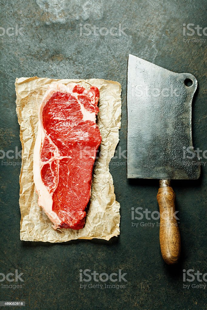 vintage cleaver and raw beef steak stock photo
