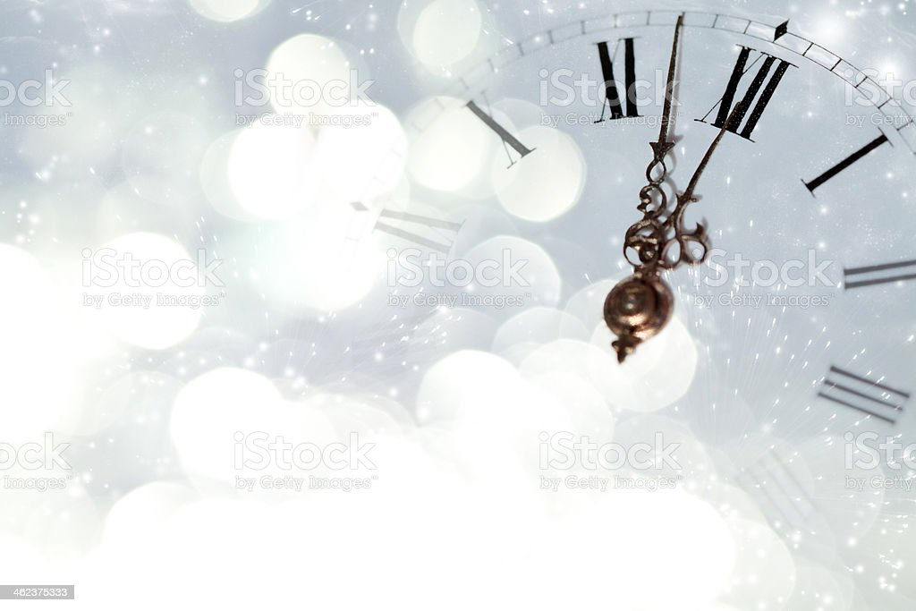 Vintage clock against holiday lights stock photo