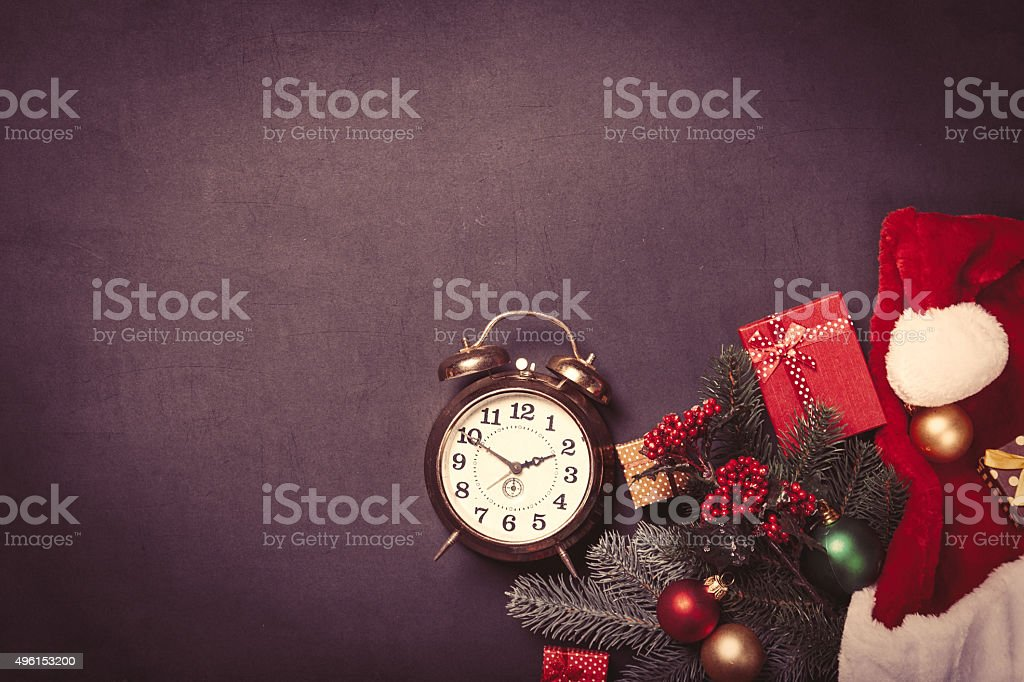 Vintage clock and christmas gifts stock photo