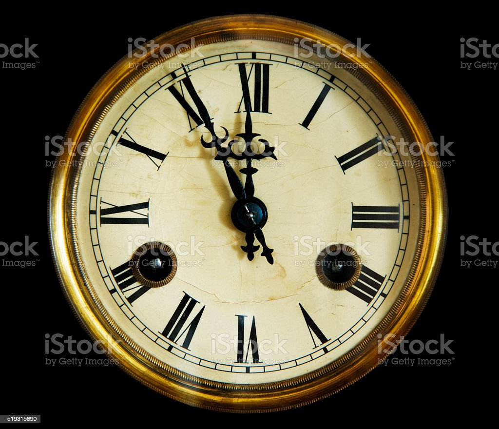 vintage clock face, isolated on a black background. stock photo