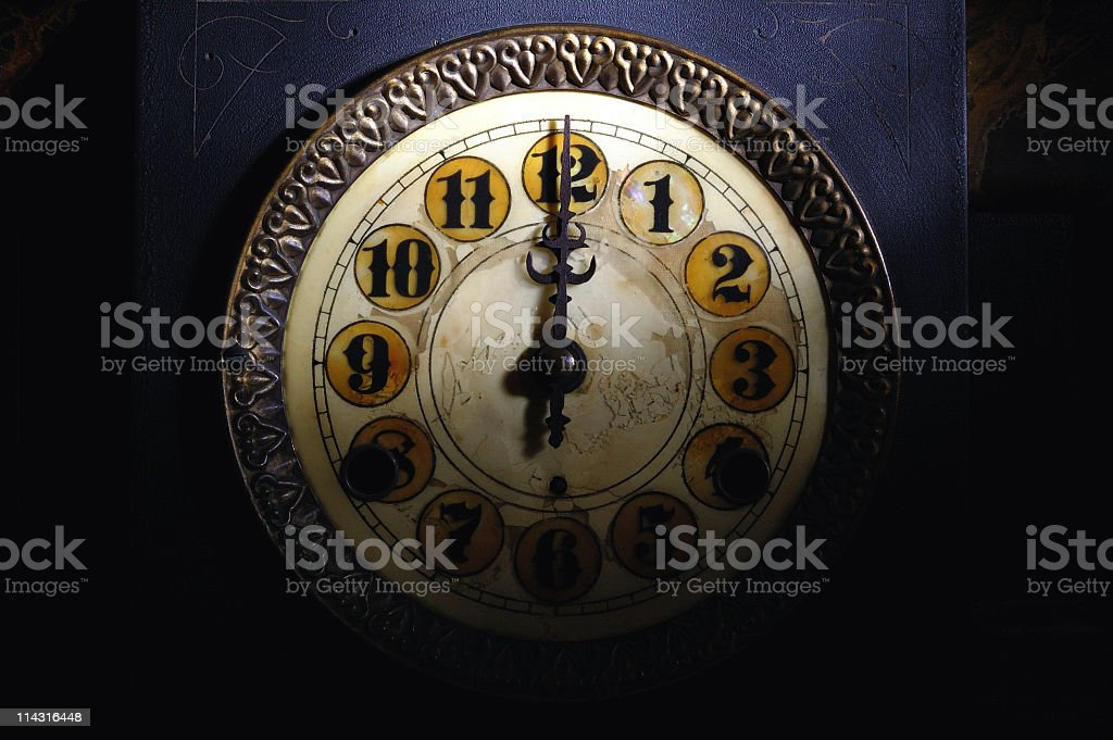 Vintage Clock Striking 12 stock photo