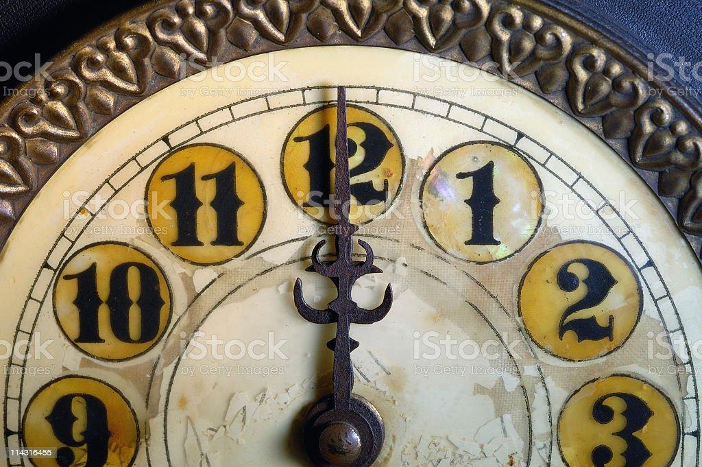 Vintage Clock Striking 12 stock photo