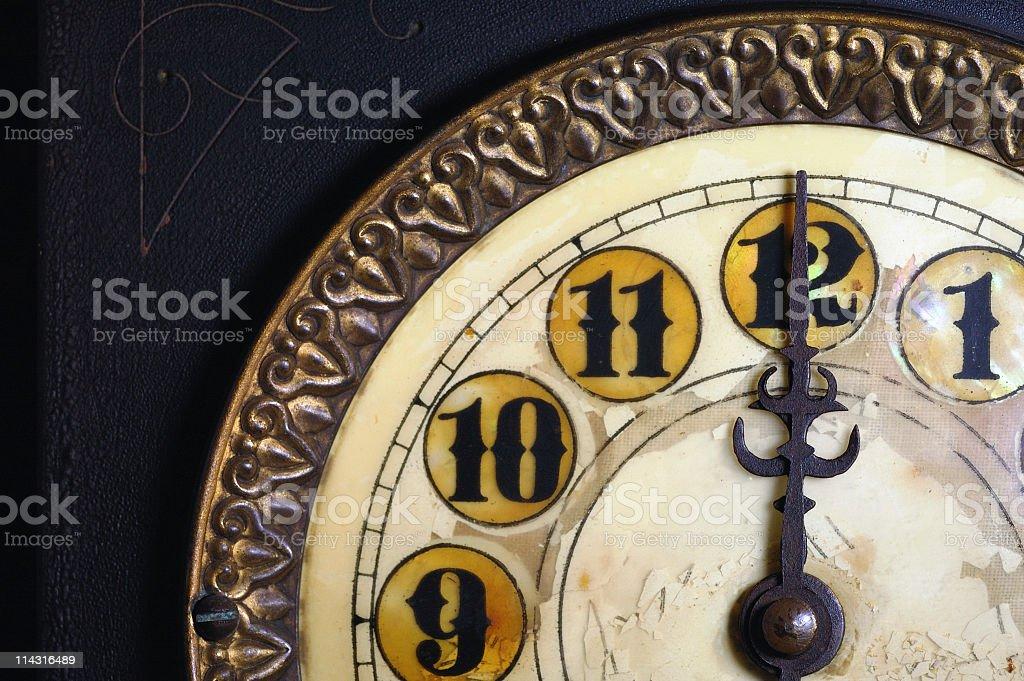 Vintage Clock Striking 12 royalty-free stock photo
