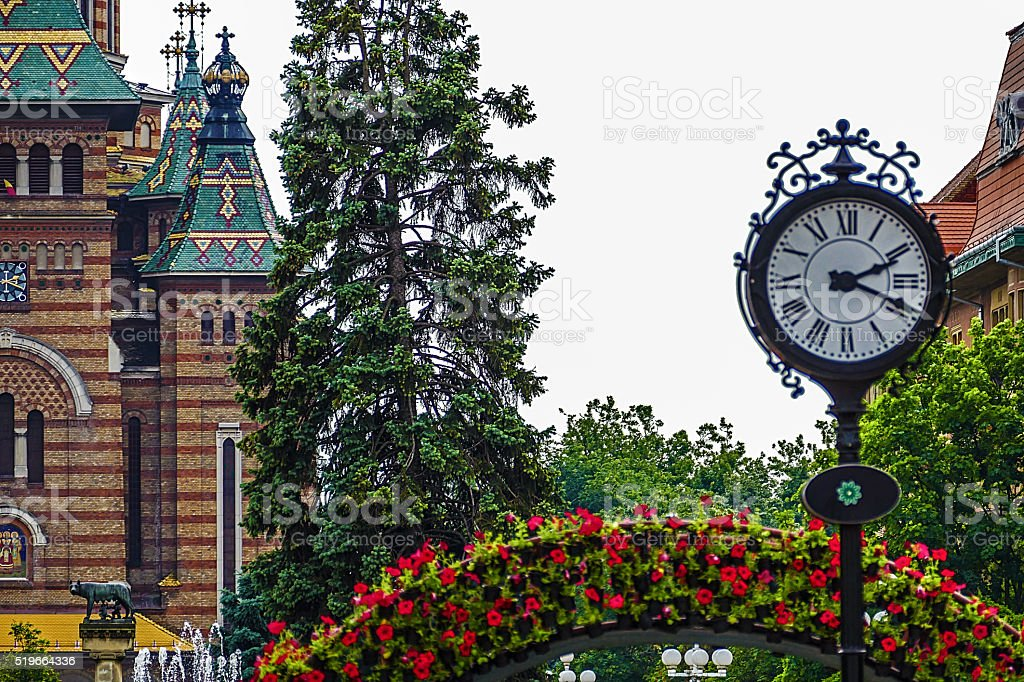 Vintage clocks, orthodox cathedral and decoration with flower stock photo