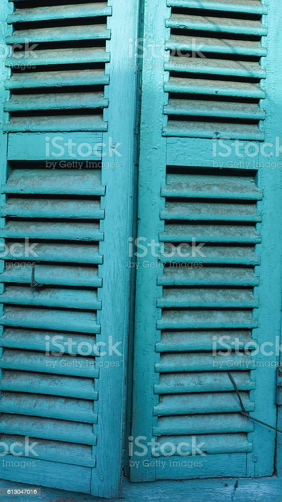 Vintage closed wood door painted blue royalty-free stock photo