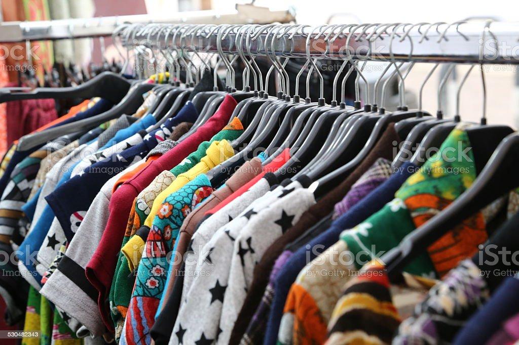 vintage clothes for sale at flea market stock photo