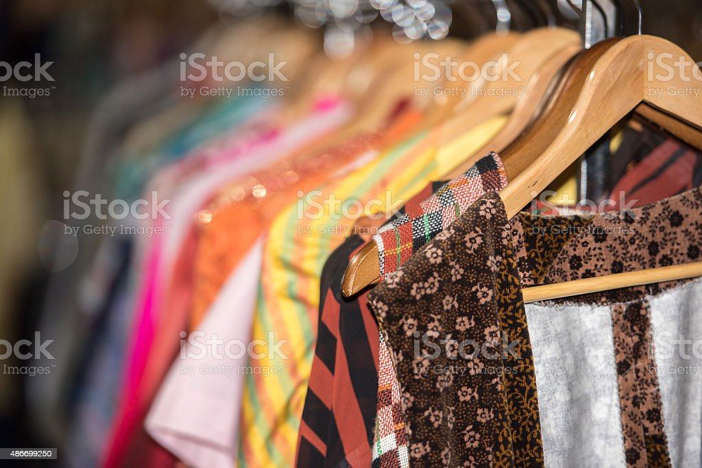 Vintage clothes for sale inside a shop stock photo