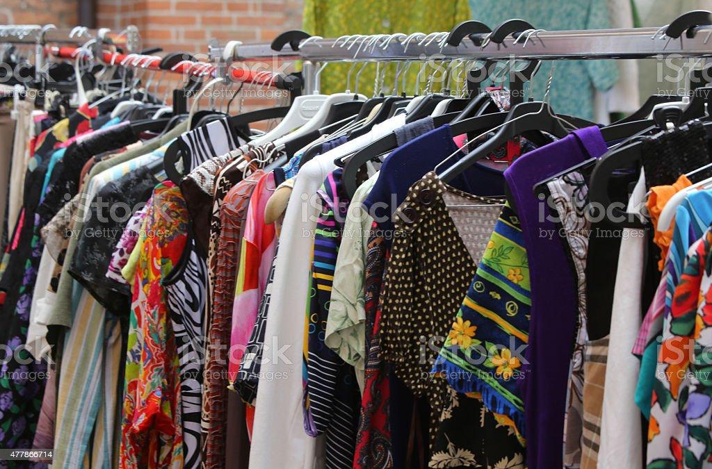 vintage clothes hanging at flea market stock photo