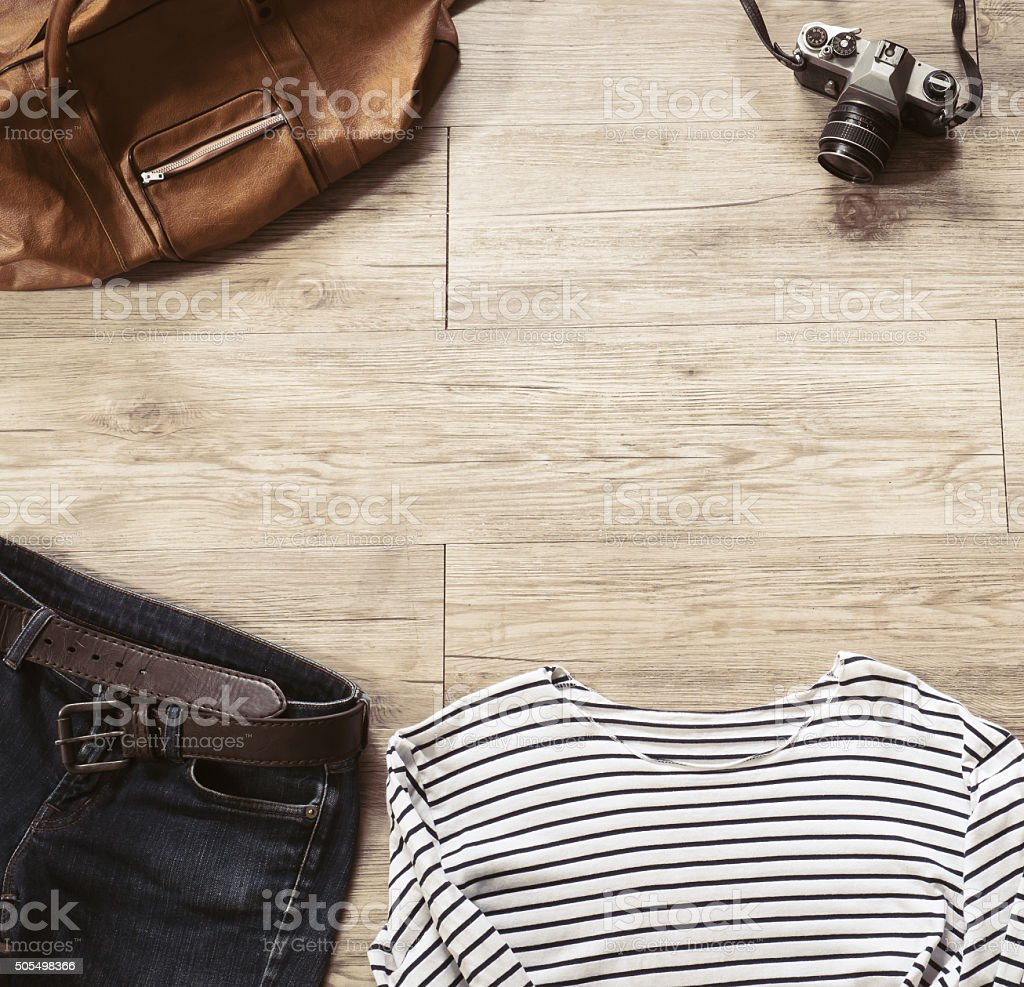 Vintage clothing and accessories on the wooden background stock photo