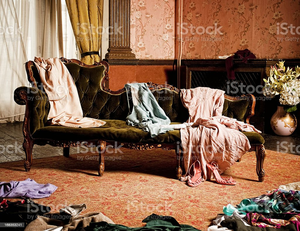 Vintage clothing scattered in a woman's dressing room royalty-free stock photo