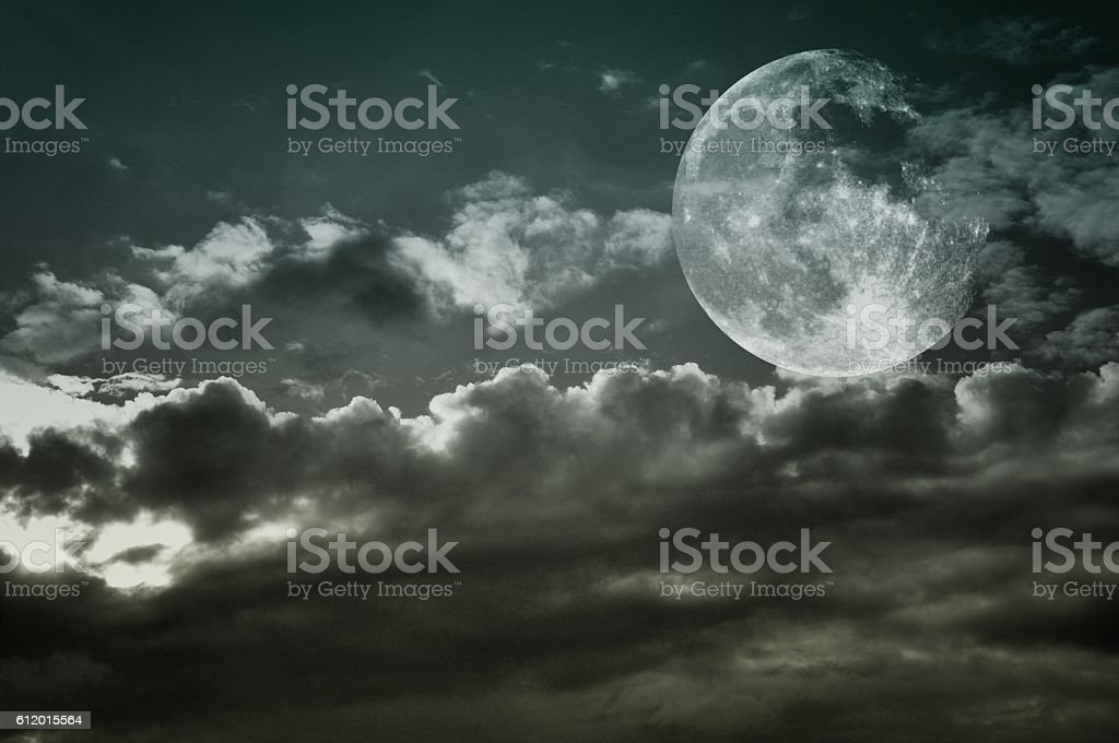 Vintage cloudy sky with full moon. Blue tones. stock photo