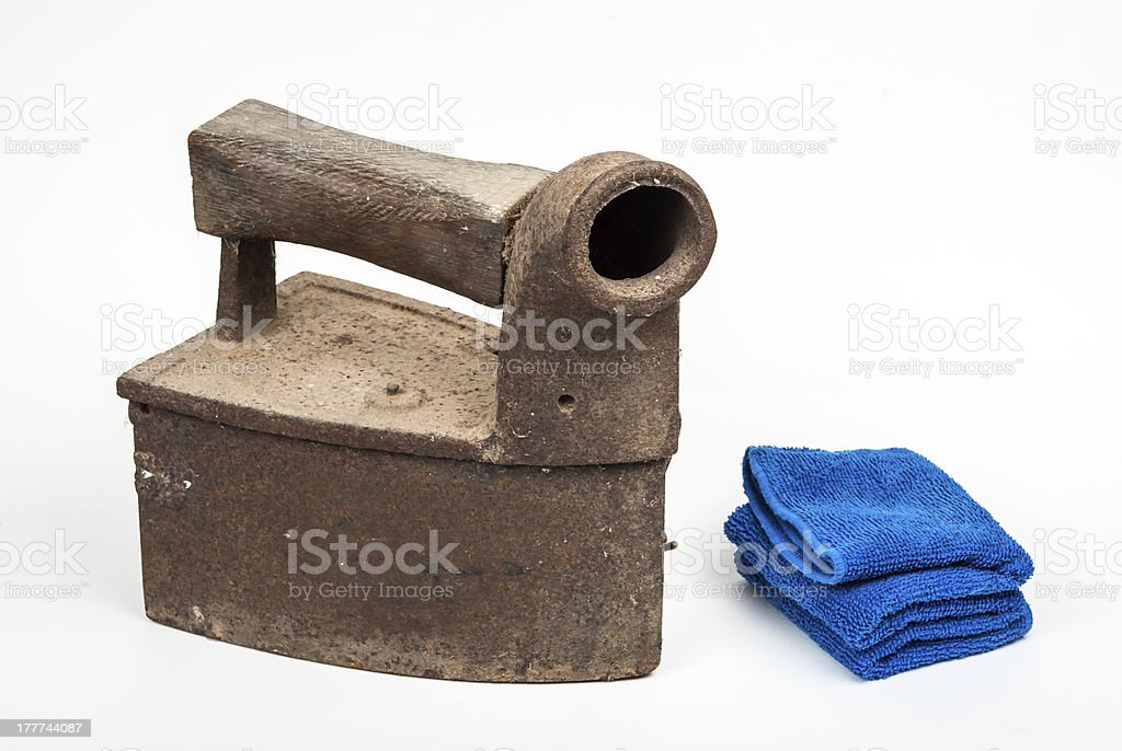 Vintage Coal Iron with Blue Towel, isolated royalty-free stock photo