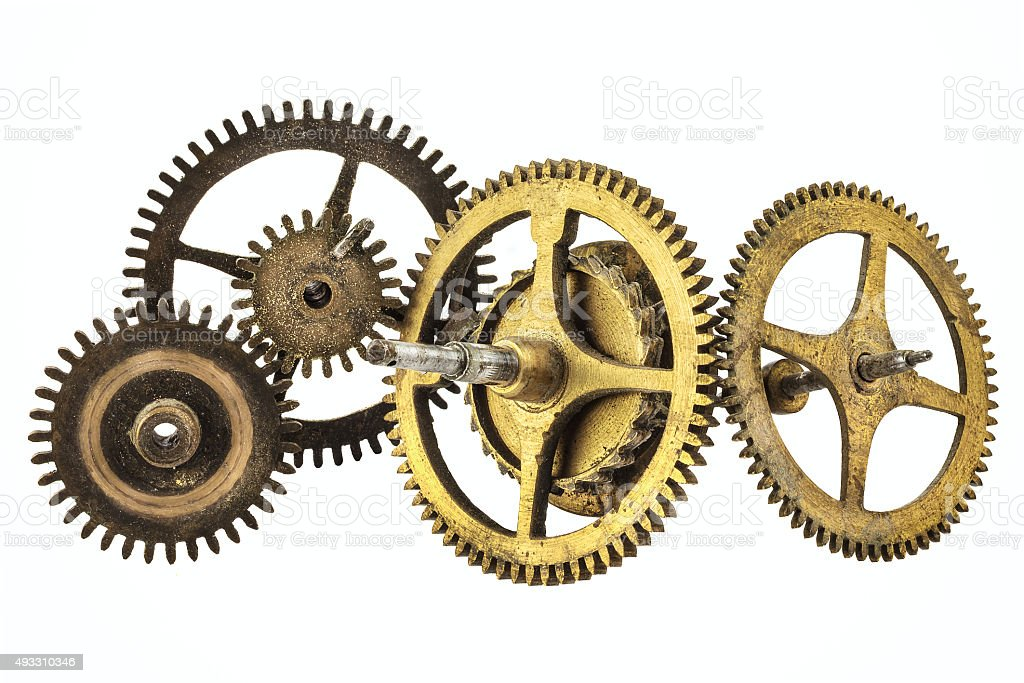Vintage cogwheels of a clock isolated on white stock photo