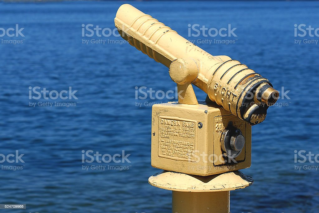 vintage coin-operated pierside telescope stock photo