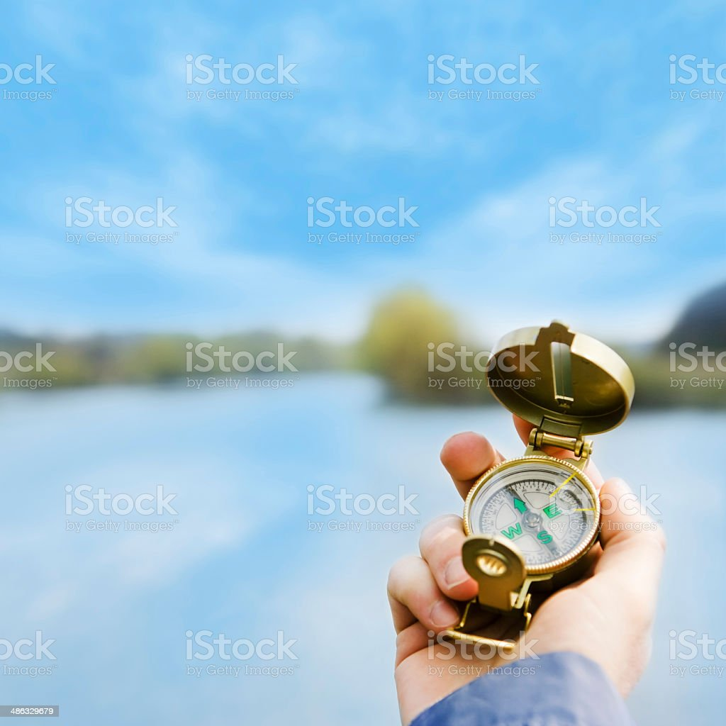 vintage compass in hand stock photo