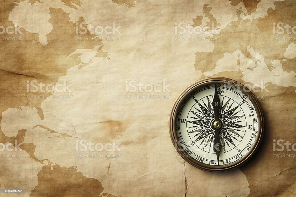 Vintage compass on old map with copy space stock photo