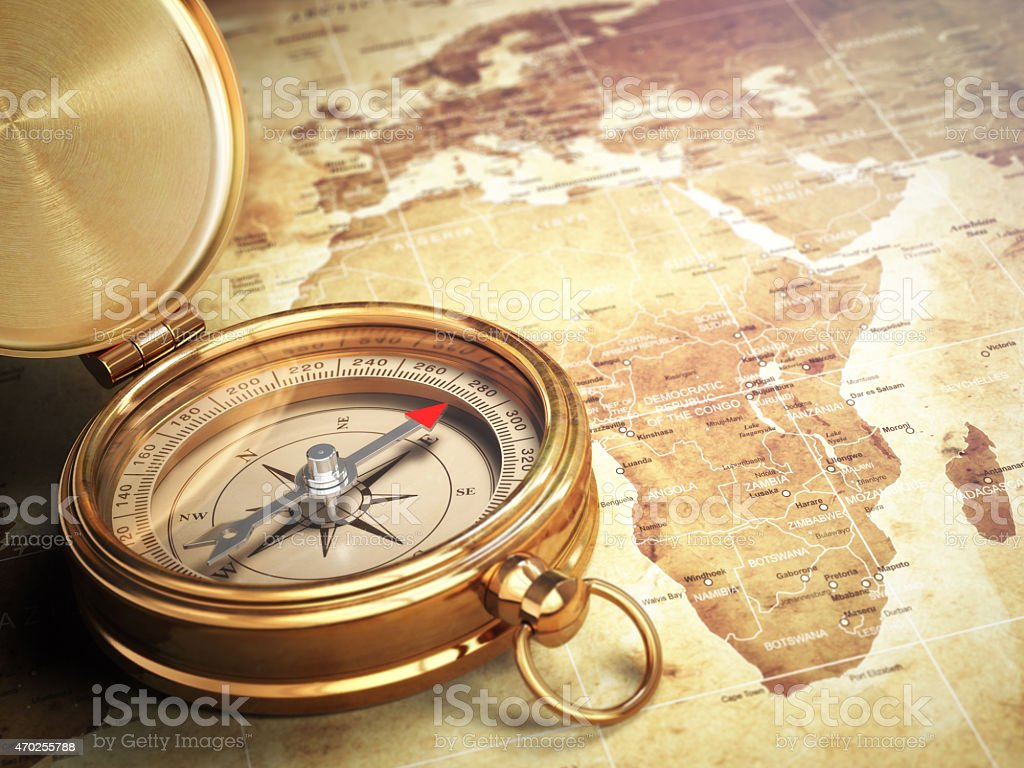 Vintage compass on the old world map. Travel concept. stock photo