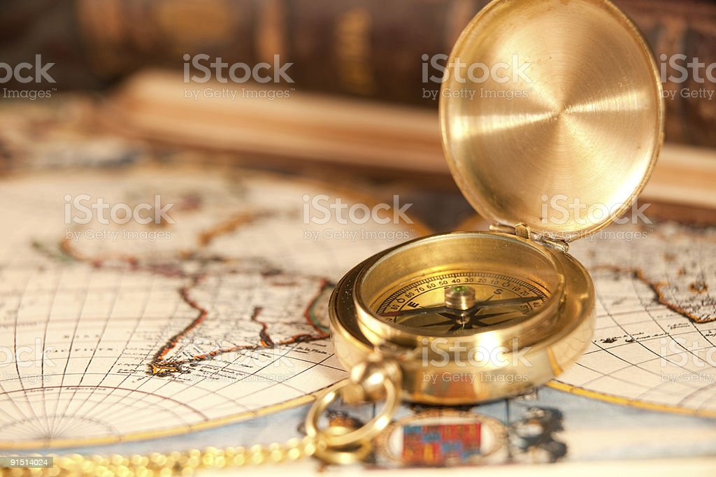 vintage compass with chain on a map stock photo