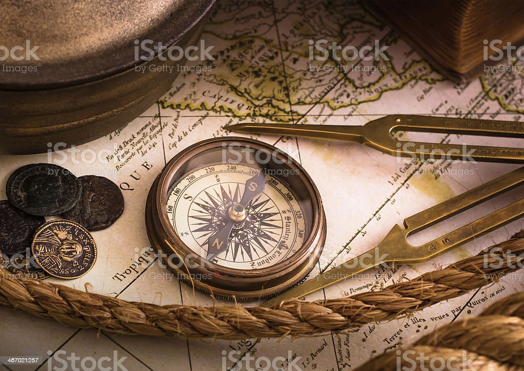 Vintage compass with map and tools stock photo