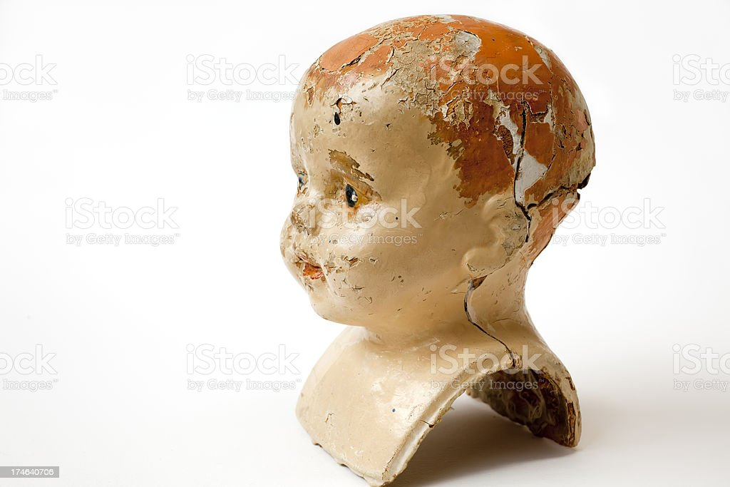 Vintage composition damaged doll head. royalty-free stock photo