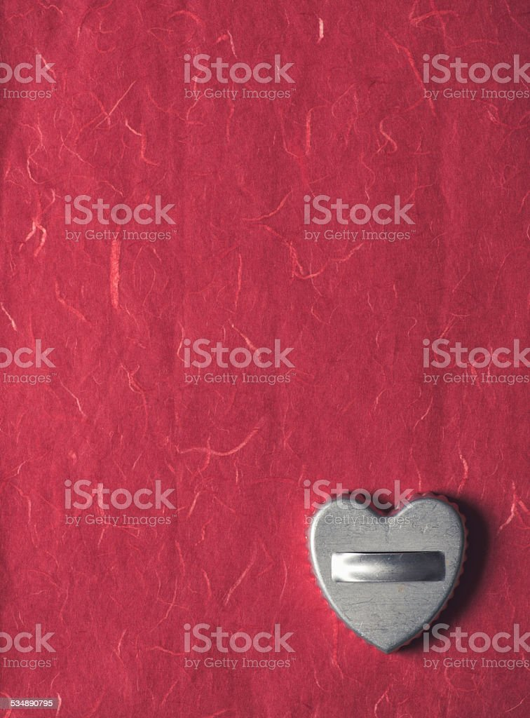 Vintage Cookie Cutter on Textured Paper stock photo