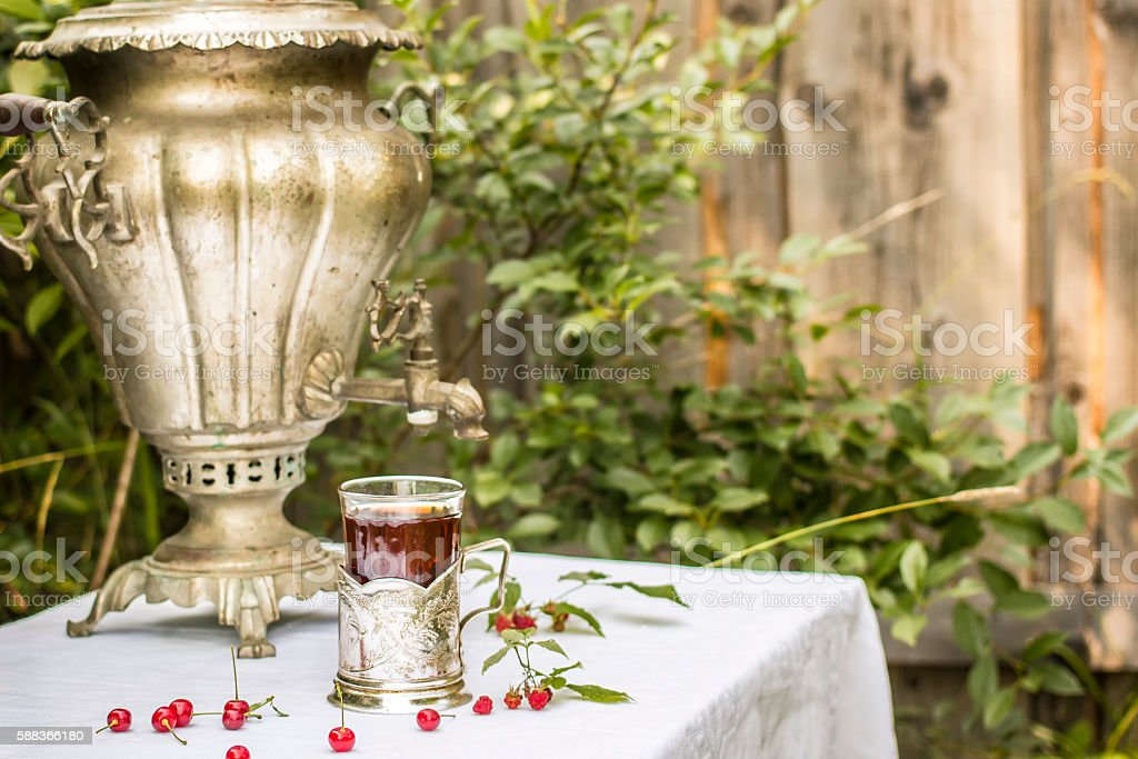 vintage copper samovar in a cup holder stock photo