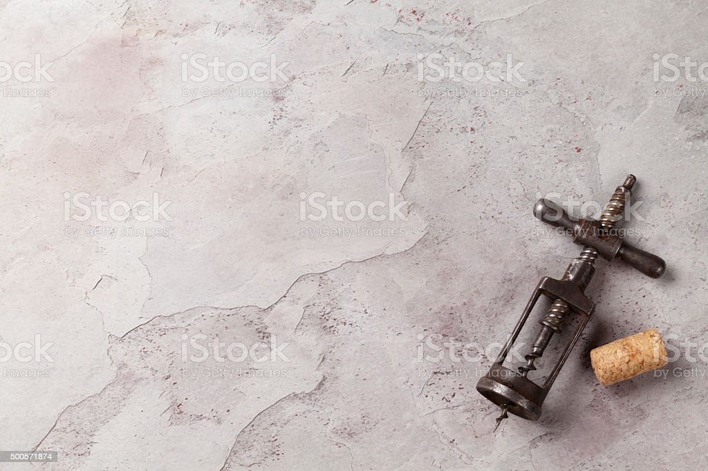 Vintage corkscrew on stone stock photo