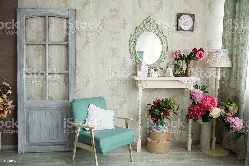 Vintage country house interior with mirror and a table with a vase...