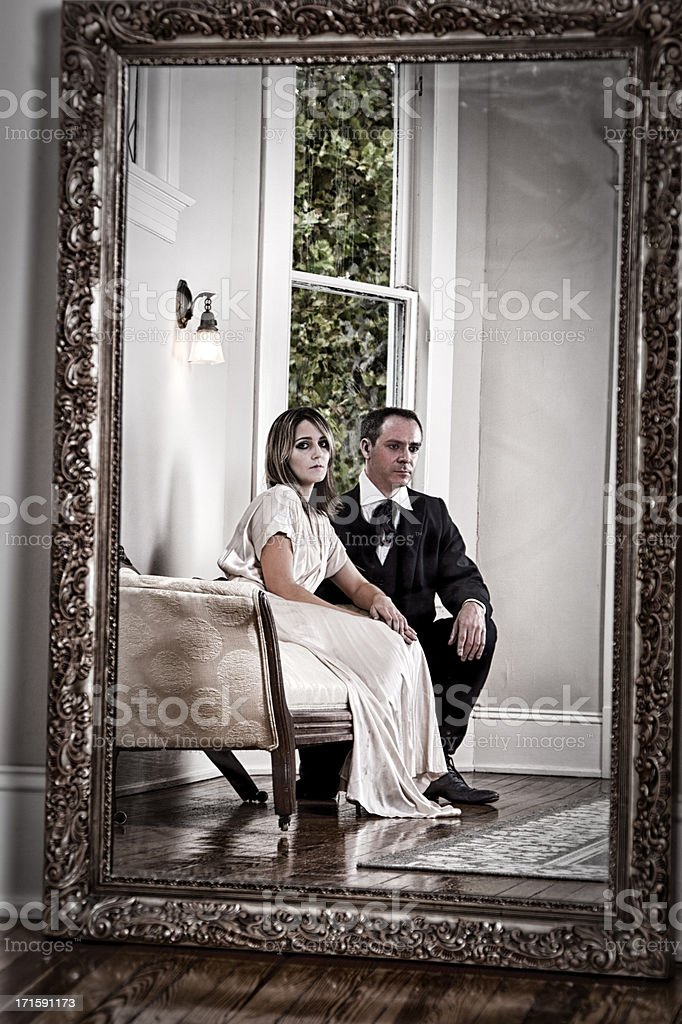 Vintage Couple Reflected in a Mirror royalty-free stock photo