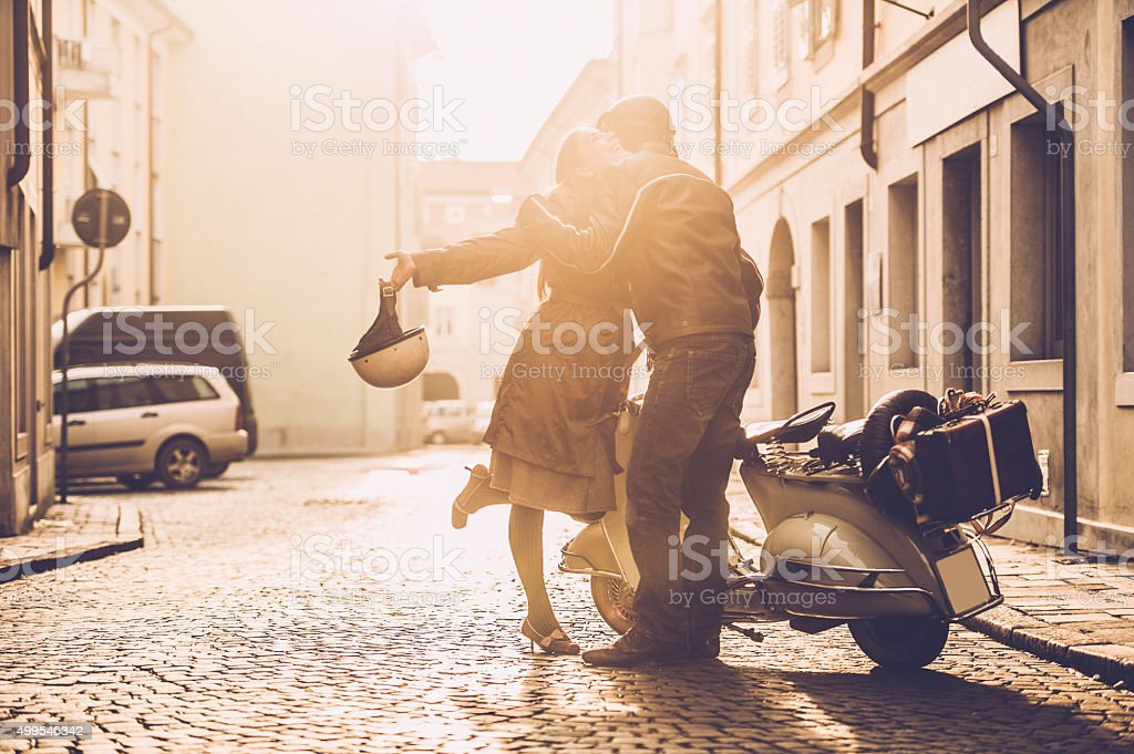 Vintage Couple with Scooter in Italy stock photo