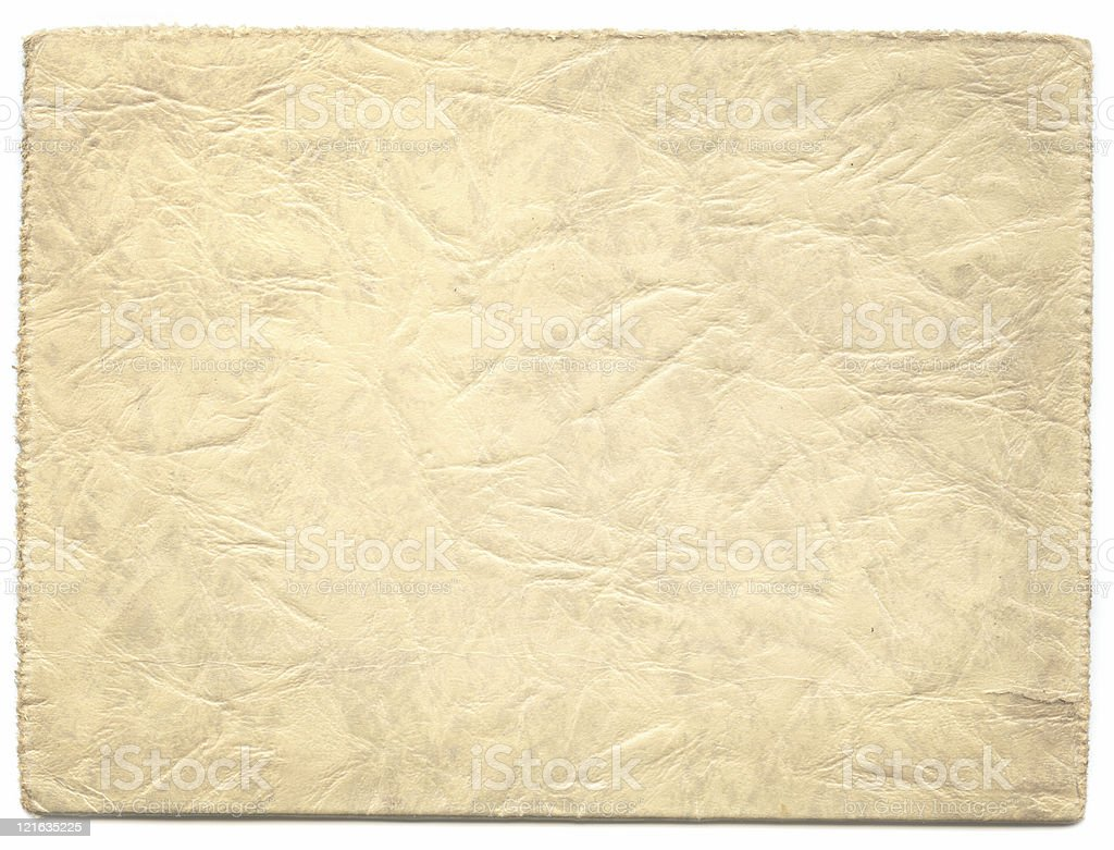 Vintage creased and crinkled paper with frayed edges royalty-free stock photo