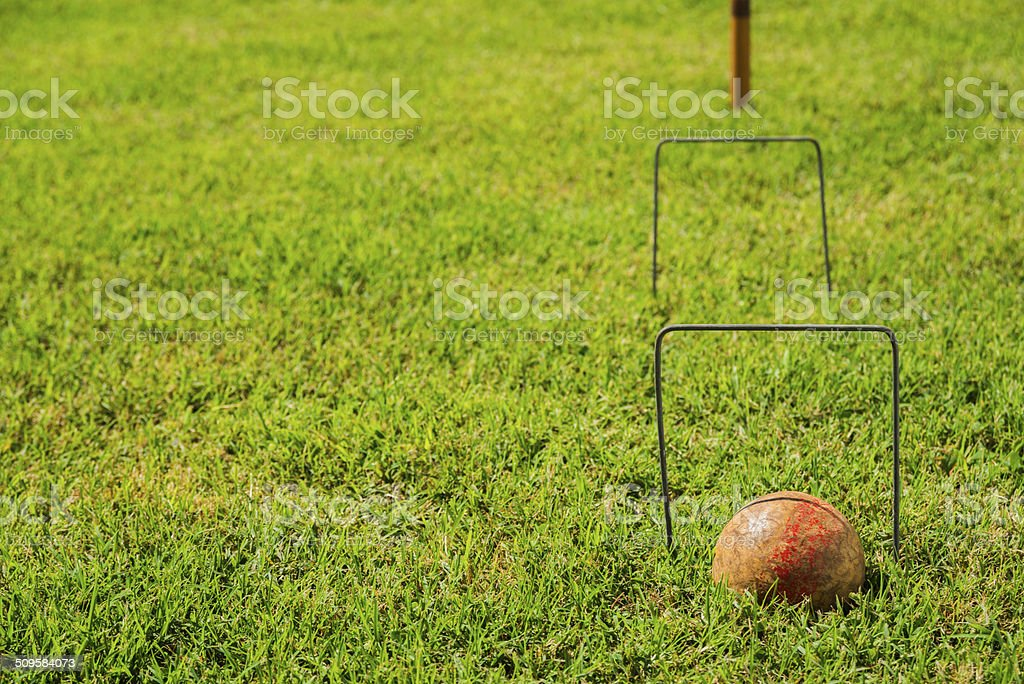 Vintage Croquet Ball in the wickets stock photo