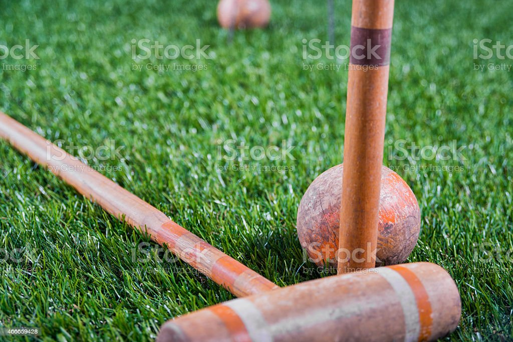 Vintage Croquet Mallet , with the ball resting against the Peg stock photo