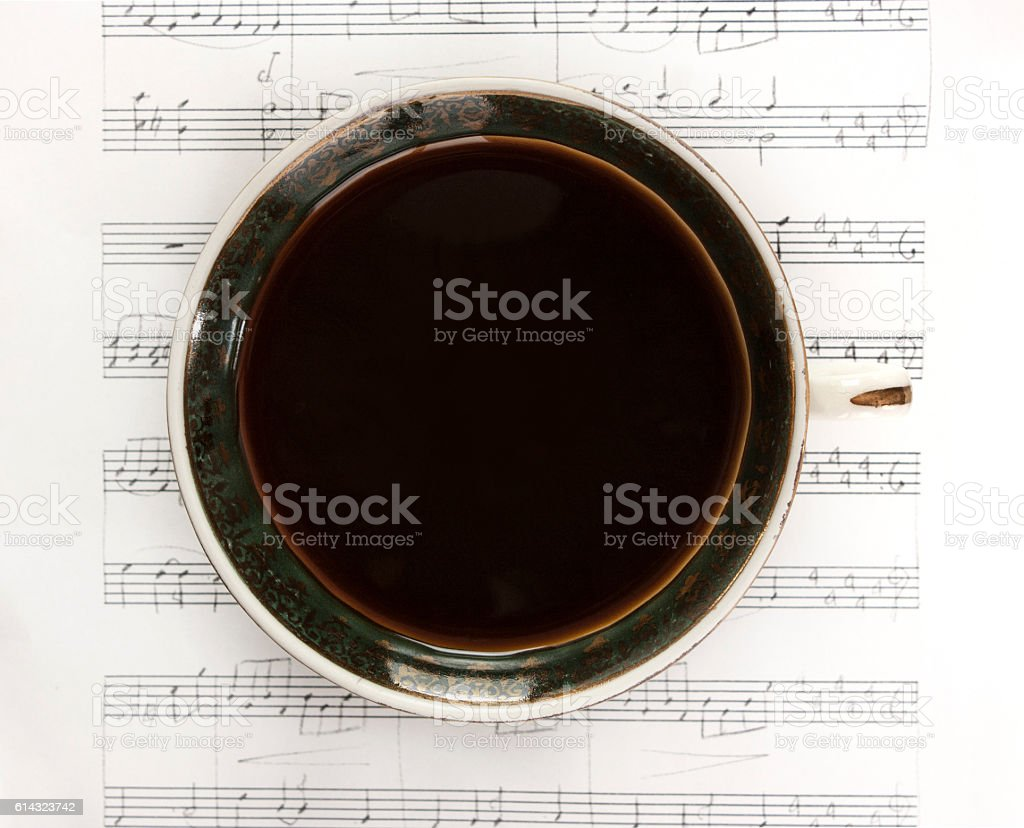 Vintage cup of black coffee on sheet music stock photo