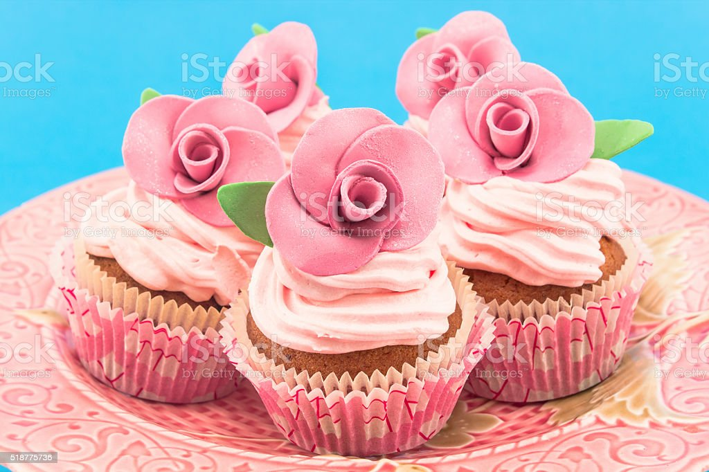 Vintage cupcakes on a blue background stock photo