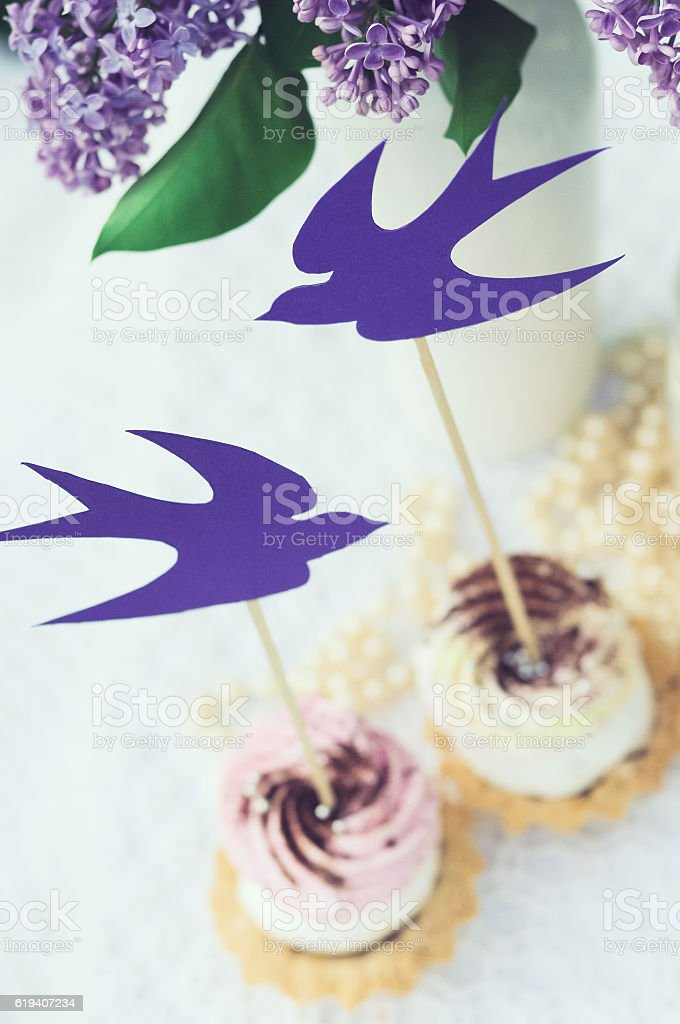 Vintage cupcakes on the table stock photo