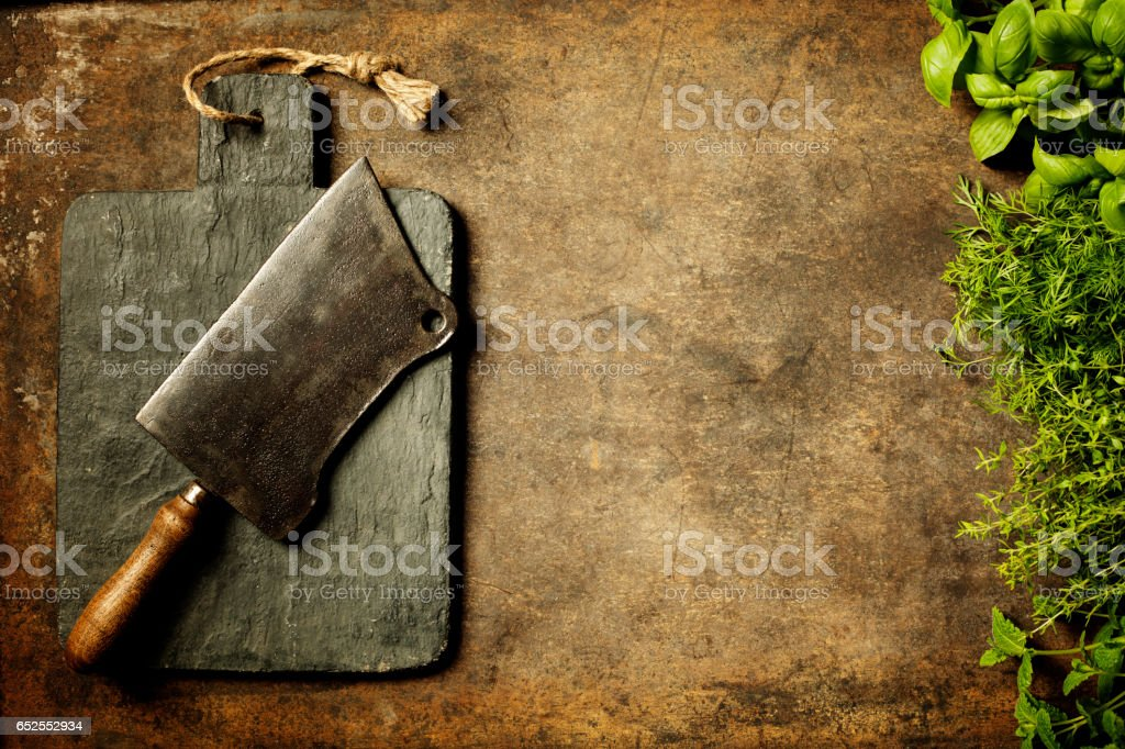Vintage cutting board,meat cleaver and cooking ingredients stock photo