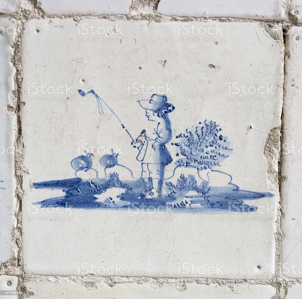 Vintage Delft blue tile with sheperd royalty-free stock photo