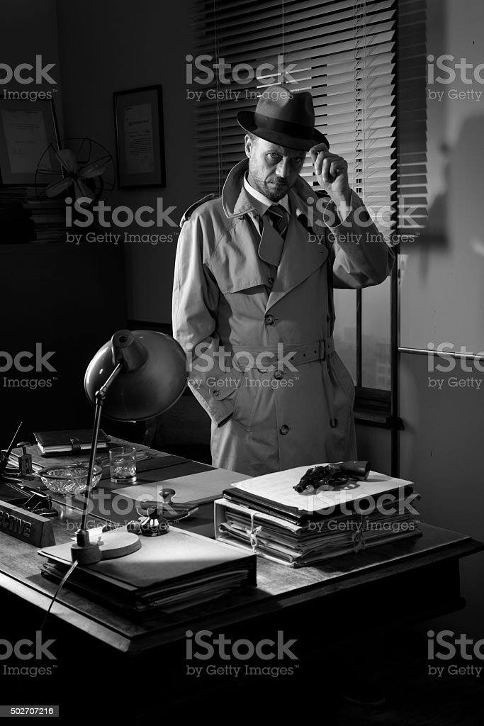 Vintage detective standing in his office stock photo