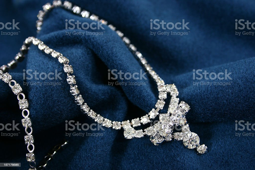 Vintage Diamond necklace on blue fabric stock photo