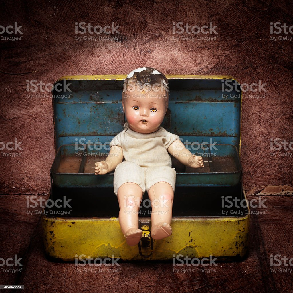 Vintage doll on a Box stock photo