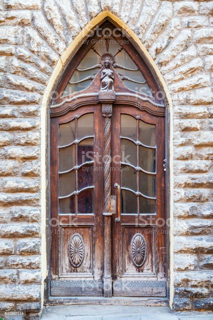 Vintage door in old Tallinn, Estonia stock photo