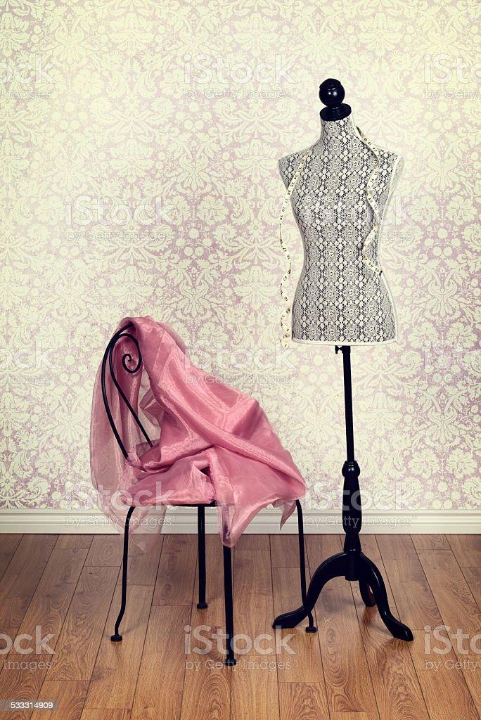 vintage dress form pink fabric stock photo